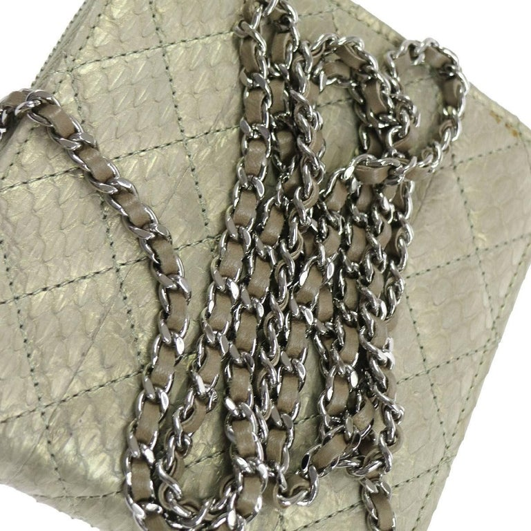 "Chanel Python Metallic Iridescent Evening Wallet on Chain WOC Crossbody Shoulder Flap Bag  Python Leather  Silver tone hardware Turnlock closure Leather lining Made in Italy Date code present Shoulder strap drop 27"" Measures 5.5"" W x"