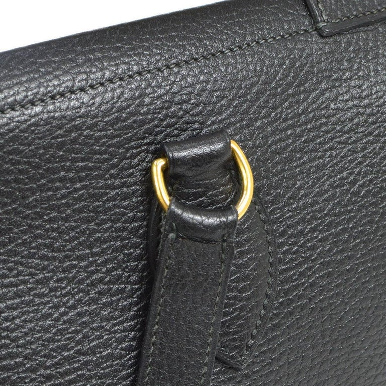 Hermes Black Leather Oversize Carryall Briefcase Travel Shopper Shoulder Tote Bag  Leather Gold tone hardware Suede lining Belted closure Made in France Date code Square E  Shoulder strap drop 27