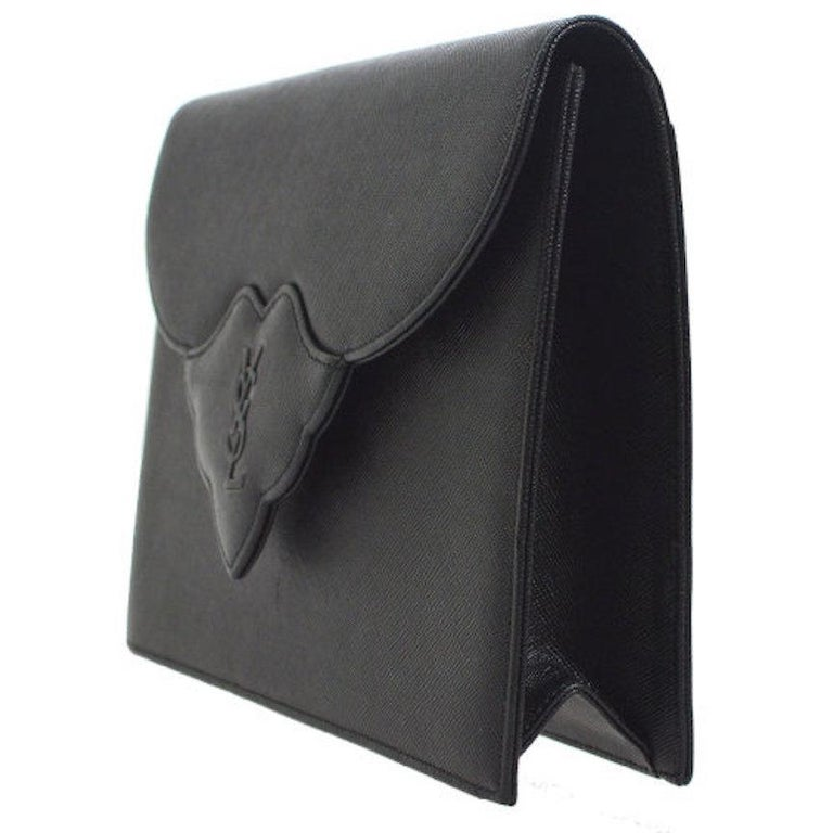 YSL Yves Saint Laurent Black Leather Envelope Evening Flap Clutch Bag  Leather Twill lining Button closure  Measures 9.5