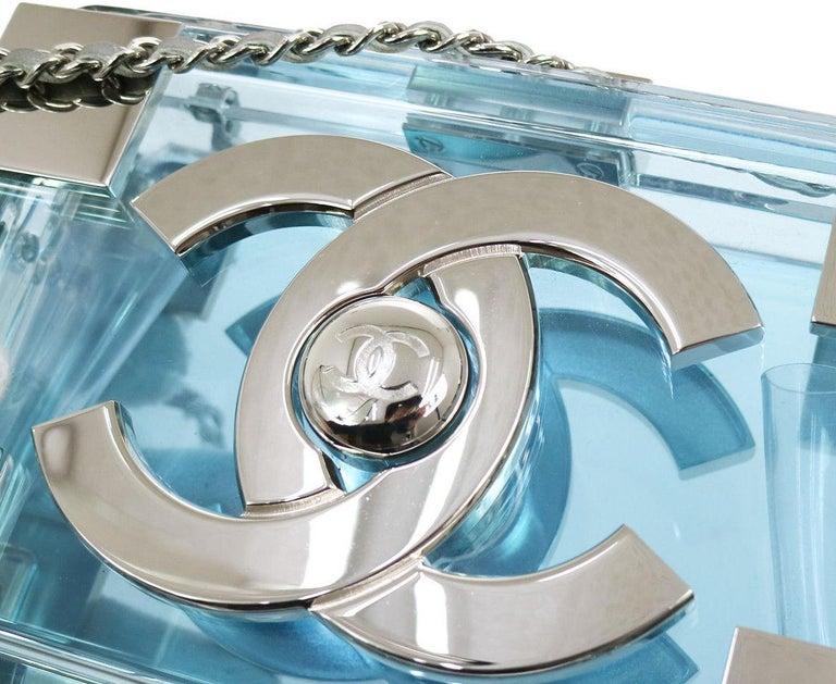 Chanel LIKE NEW Rare Plexiglass Baby Blue Lego 2 in 1 Clutch Shoulder Bag in Box  Plexiglass Leather Metal Silver tone Turnlock closure Date code present Shoulder strap drop 24