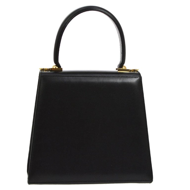 Salvatore Ferragamo Black Leather Gold Mini Kelly Style Top Handle Bag  Leather Gold tone hardware Leather lining Made in Italy Measures 8.75