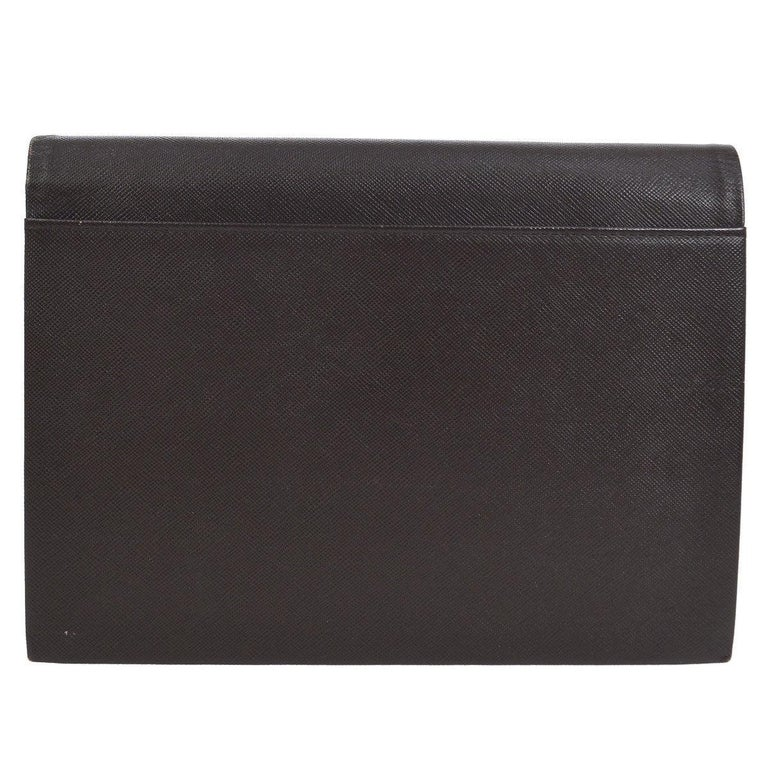 YSL Yves Saint Chocolate Brown Leather Envelope Evening Flap Clutch Bag  Leather Twill lining Button closure  Measures 9.5