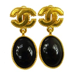 Chanel Gold Textured Logo Black Evening Drape Dangle Drop Earrings