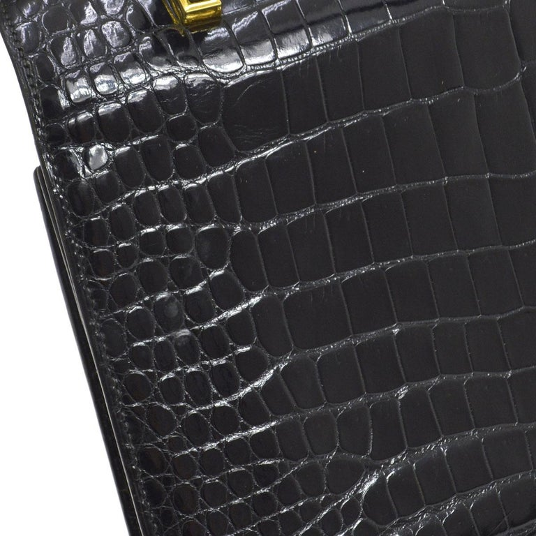 Hermes Rare Black Leather Gold Emblem Evening Kelly Style Top Handle Satchel Bag  Crocodile leather Gold tone hardware Leather lining Made in France Handle drop 4.5
