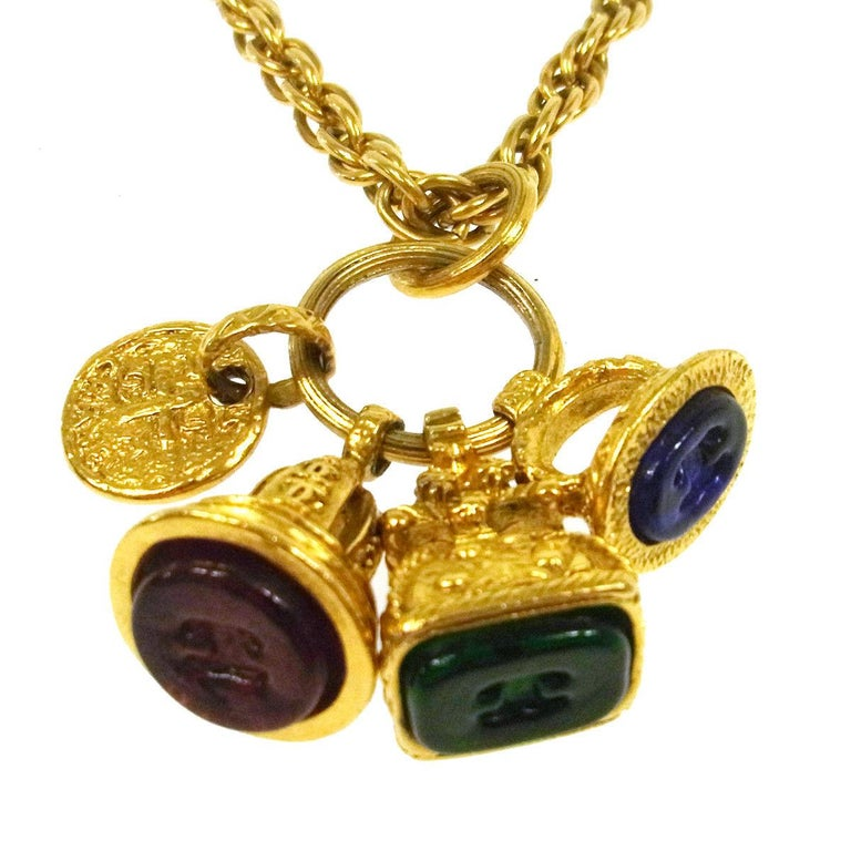 Chanel Gold Multi Color Gripoix Charm Chain Pendant Chain Evening Necklace in Box  Gripoix (Poured Glass) Metal Gold tone Lobster closure Date code present Made in France  Charms measure 0.5