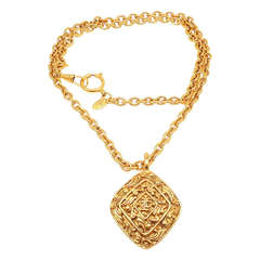 CHANEL Vintage Long Textured Amulet Logo Necklace