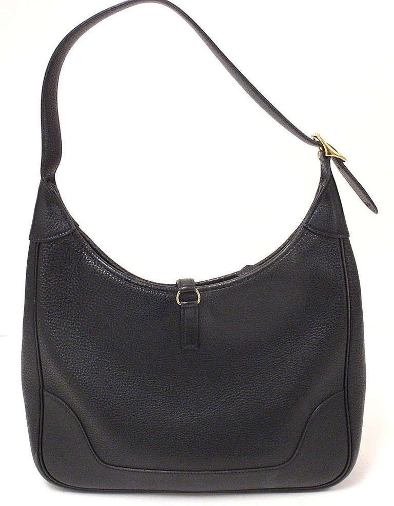 HERMES TRIM 31CM BLACK TAURILLON CLEMENCE LEATHER SHOULDER BAG   This bag is in GREAT condition. Features black clemency leather exterior and suede and leather interior.Zipper closure exterior with leather strap.  Interior includes one large open