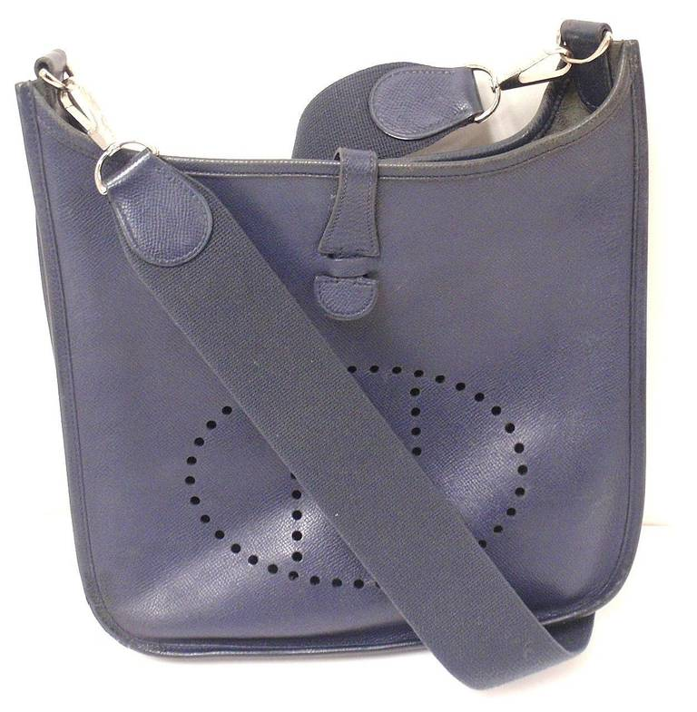 HERMES EVELYNE PM NAVY EPSOM LEATHER SHW SHOULDER BAG, 2006, OK   This bag is in OK condition. Features the navy epsom leather.  Please note, color can vary greatly from monitor to monitor.   Exterior: Scratches/Stains: There are one or two