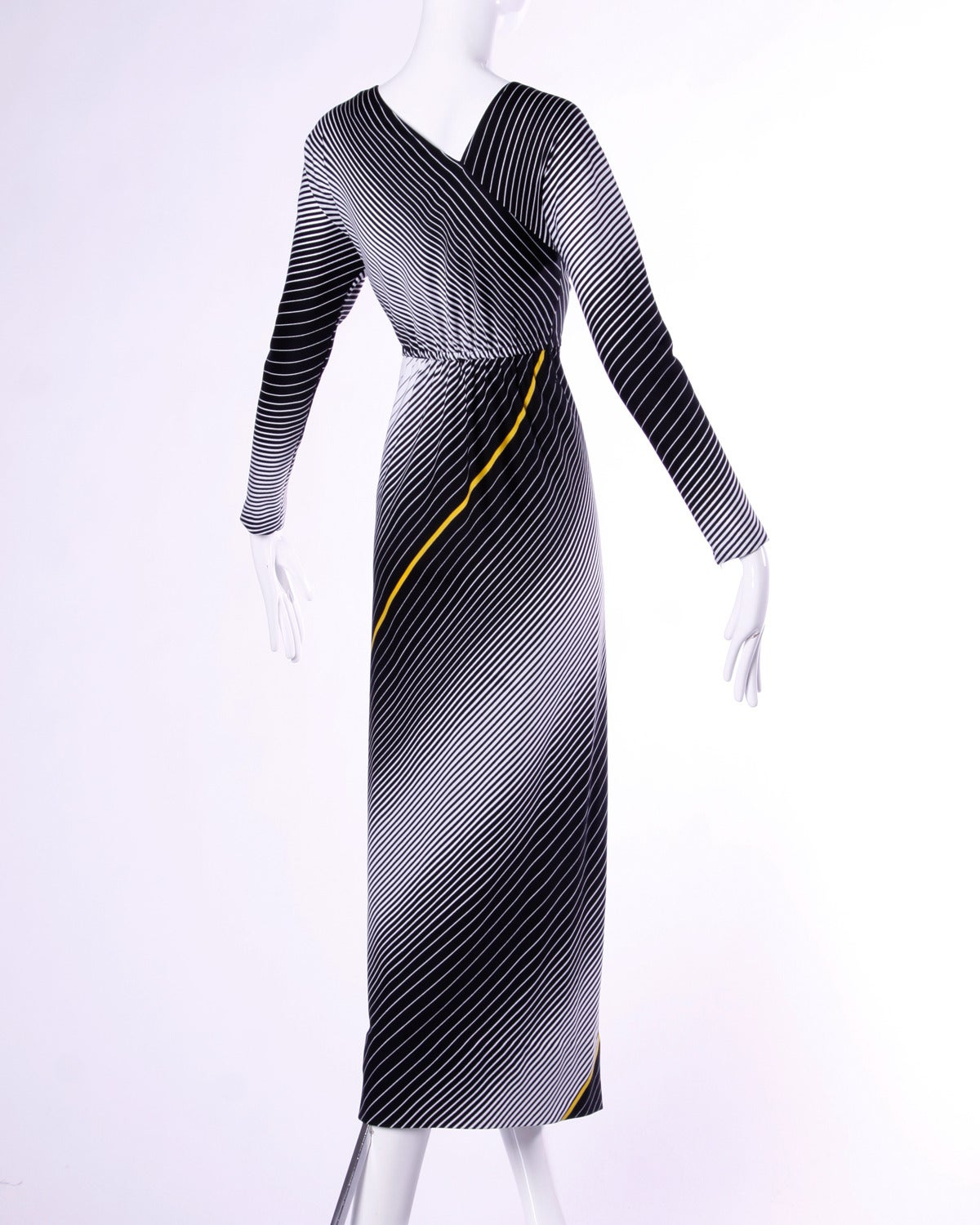 Vintage op art maxi dress by Victor Costa with black and white stripes.   Details:  Unlined No Closure/ Fabric Contains Stretch Marked Size: 6 Color: Black/ White/ Yellow Fabric: Polyester Label: Victor Costa  Measurements:  Bust: