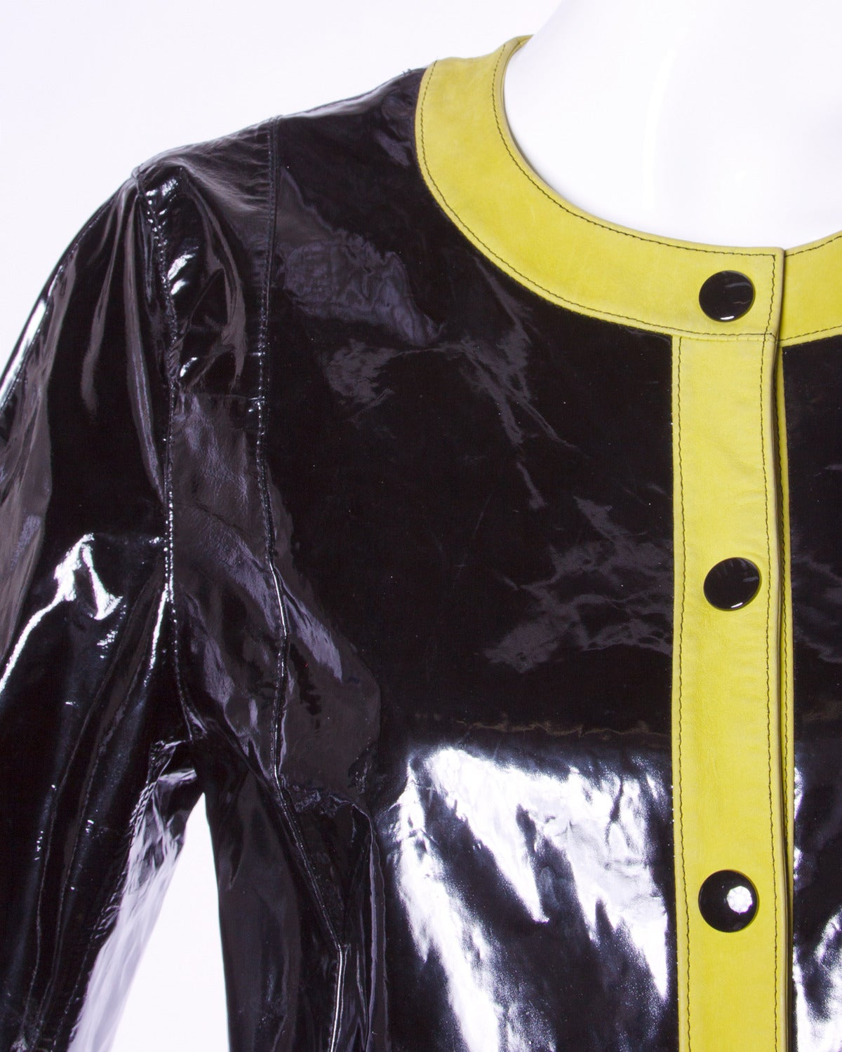 Shiny black patent genuine leather bomber jacket by Escada. Front snap closure and chartreuse genuine leather trim.