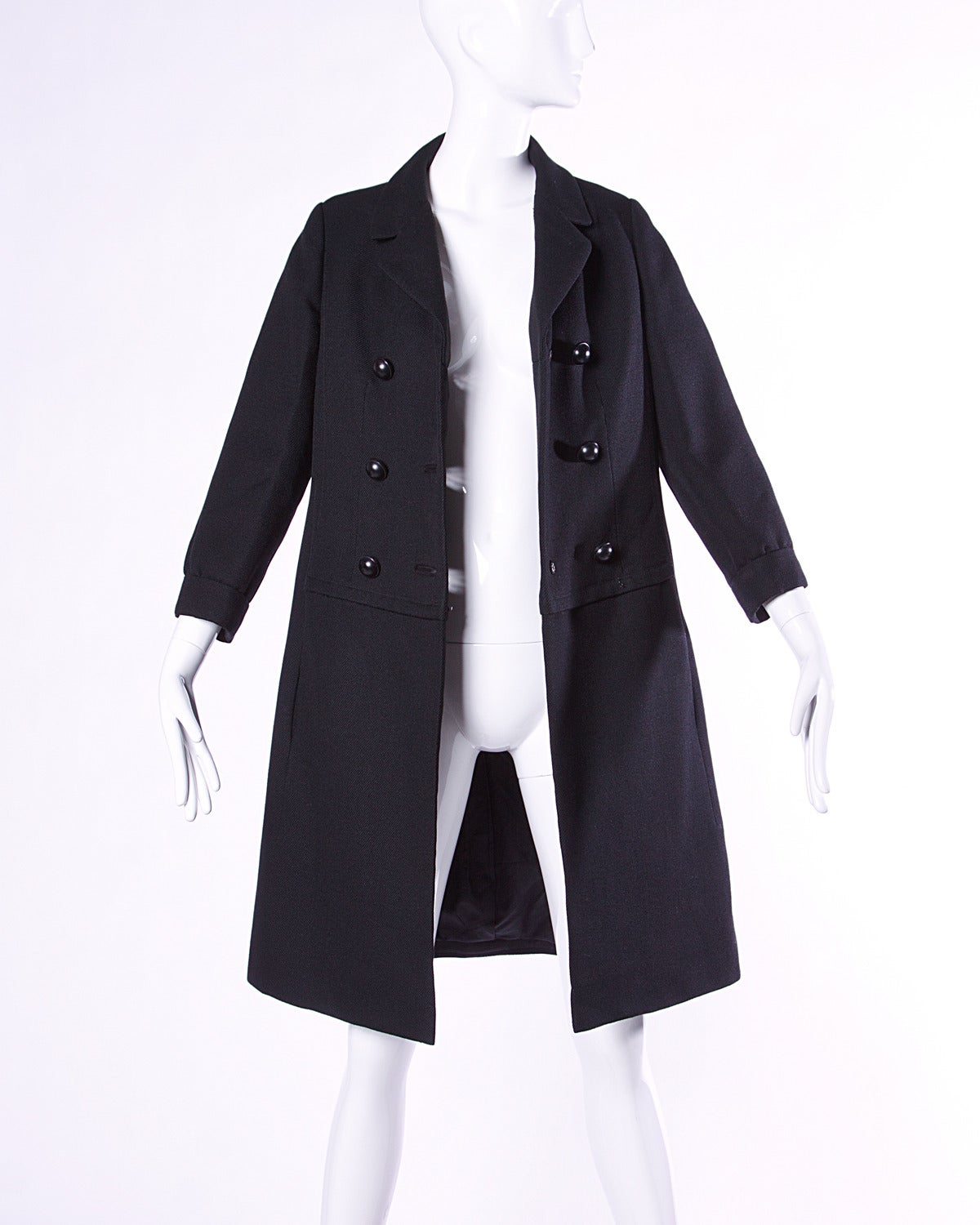 Gorgeous vintage black wool pea coat by Christian Dior in pristine condition. Double breasted buttons and notched lapels.  Details:  Fully Lined Side Pockets Front Button and Hook Closure Marked Size: 8 Estimated Size: Medium Color: