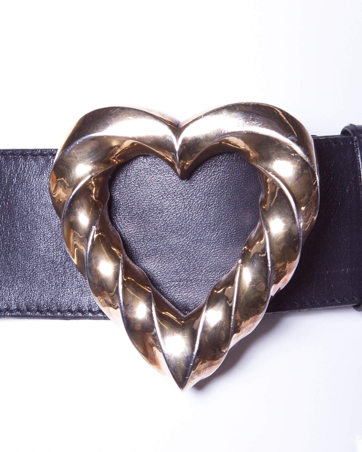 Iconic Escada vintage belt with a giant goldtone heart buckle and smaller heart detailing around the belt.