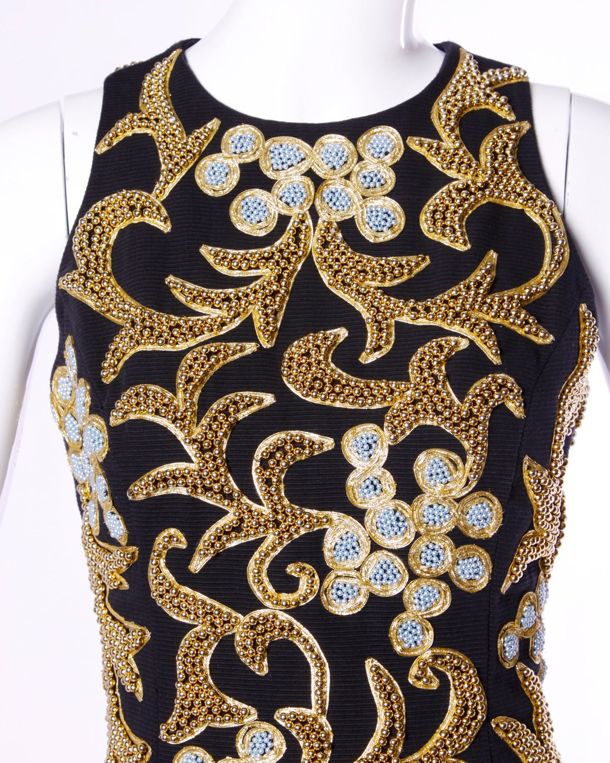 Beautiful black dress by Bill Blass with metallic silver and gold Baroque-inspired beadwork.