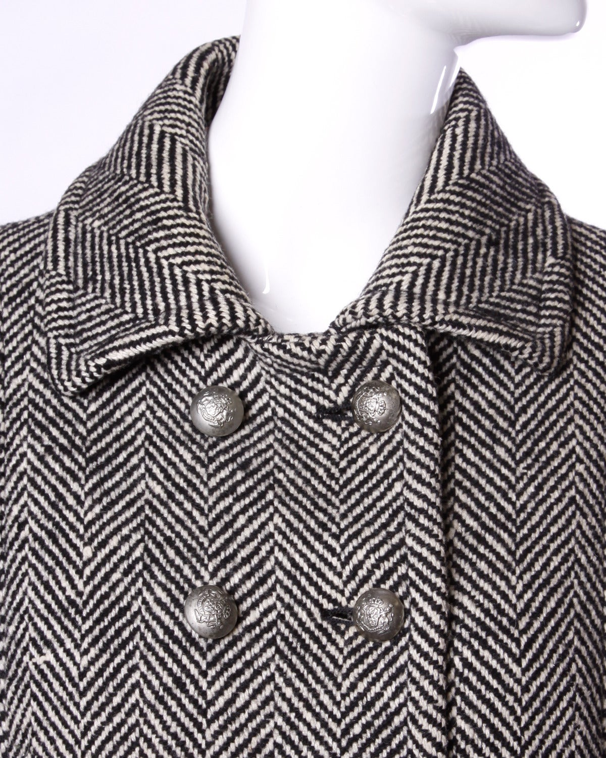 Gorgeous black and white military-inspired herringbone coat by Jean Louis Scherrer for Marshall Field & Company. Heavy silvertone double breasted buttons and classic shape. Hand tailoring and gorgeous quality.  Details:  Fully Lined Front