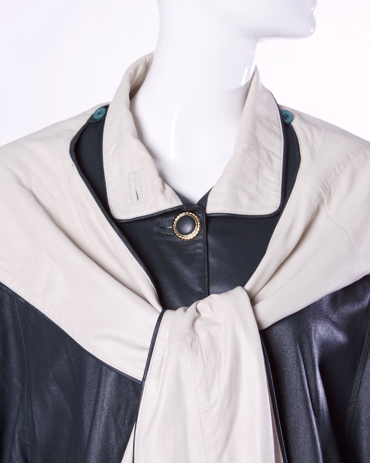 Vintage leather coat with a detachable hood that buttons on and off by Escada.