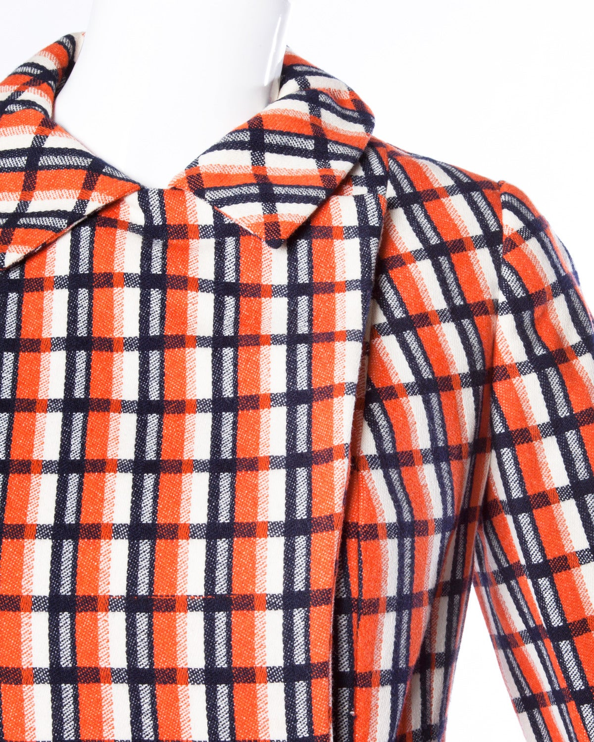 Vibrant plaid jacket and skirt set by Bill Blass for Maurice Rentner. Gold buttons and chain detail. Pleated skirt.  Details:  Fully Lined Front Snap Closure On Jacket/ Side Hook and Zip Closure On Skirt Estimated Size: XS Color: Orange/