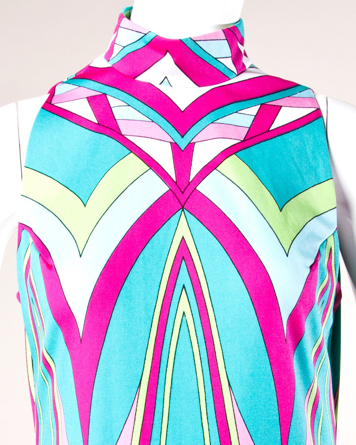 Amazing colorful op art maxi dress in light weight silky polyester by Cirette (a division of Paganne). Sleeveless sleeves and rear zip closure.  Details:  Unlined Rear Zip Closure Fabric: Light Weight Polyester Label: Cirette (A division of