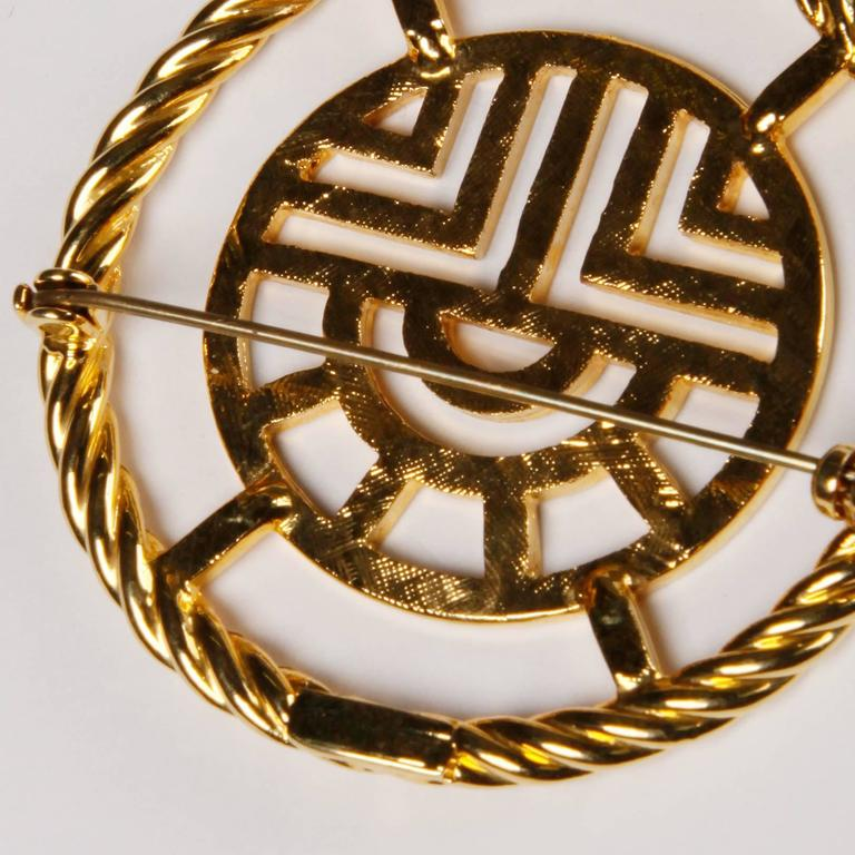 Large gold tone Louis Feraud modernist brooch from the 1960s. Signed on the back. The piece measures approximately 2