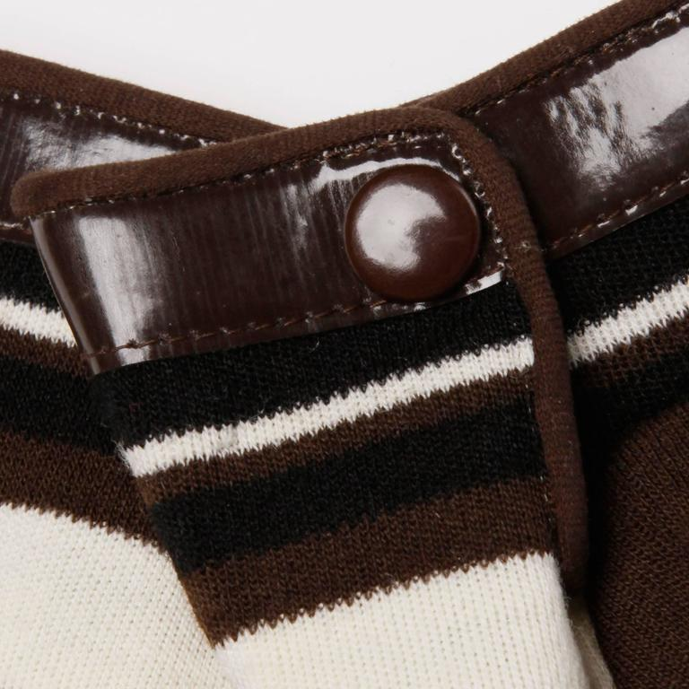 Gorgeous vintage Pierre Cardin gloves with brown vinyl trim. Gloves are wool knit in brown, black and off white stripes. Unlined. Marked size 3. Fits like a modern size medium.