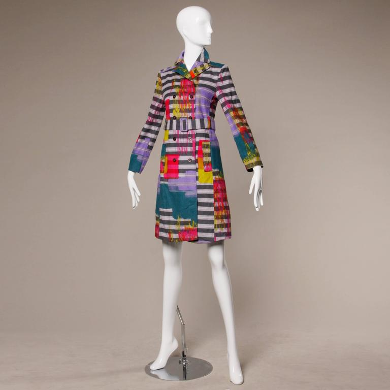 Vibrant neon paint splash striped coat in ultra fine corduroy by Christian Lacroix with matching sash belt. Double breasted button closure. Fully lined. Made in France. Marked size 36 and fits like a modern US small. The measurements are as