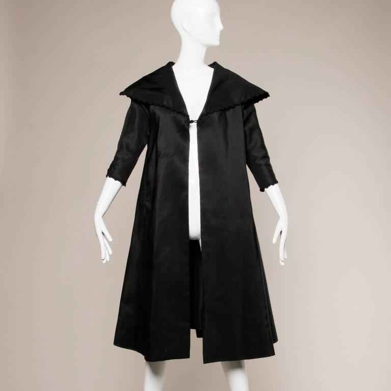 1960s Vintage Black Silk Satin Swing Coat With A Huge