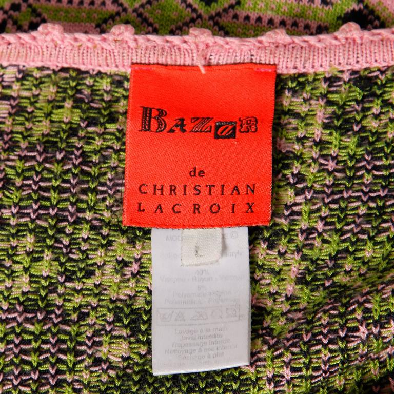 Pink knit top with short sleeves by Christian Lacroix. Lace detail down the front.