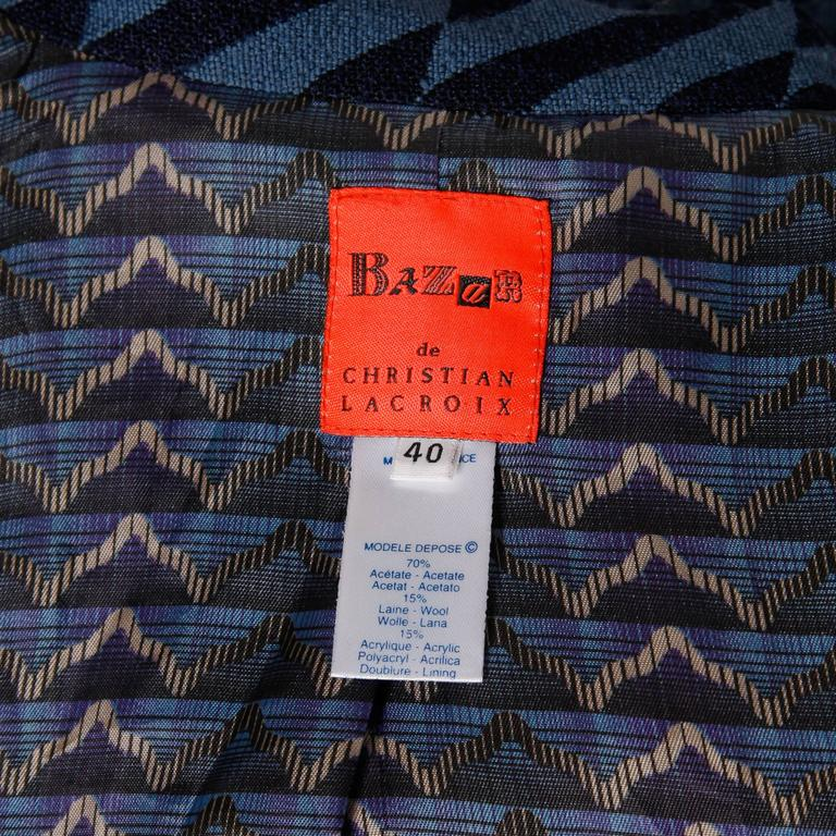 Vintage two tone blue blazer jacket by Christian Lacroix in diagonal broken stripes. Fully lined with front closure. Fabric content is 70% Acetate, 15% Wool, and 15% Acrylic. The marked size is 40 and the jacket fits like a modern size large. The