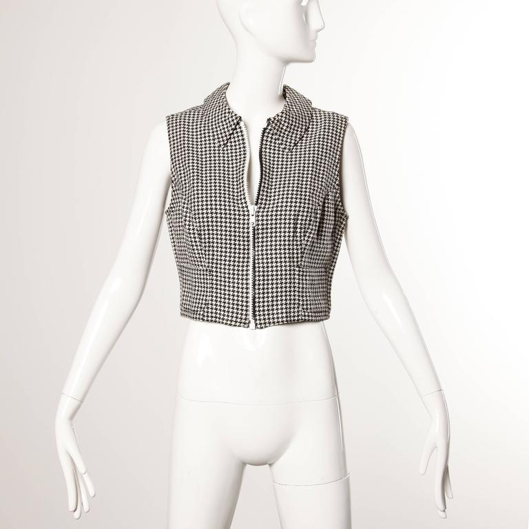 Sporty 1990s black and white houndstooth sleeveless jacket with a two-toned zip up front AND back! By Versace Jeans Couture.