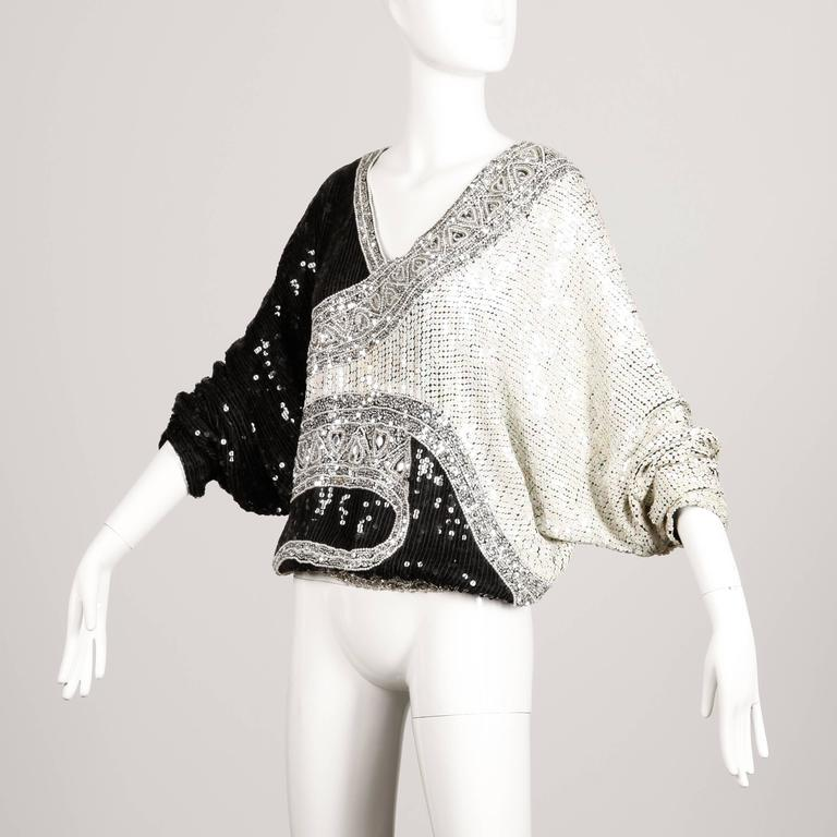 Gorgeous vintage 1980s silk batwing or dolman top encrusted with thousands of sparkling sequins, beads and rhinestones. Elastic waistband and V-neck. By Judith Ann. The marked size is medium, but this will also fit sizes small and large due to the