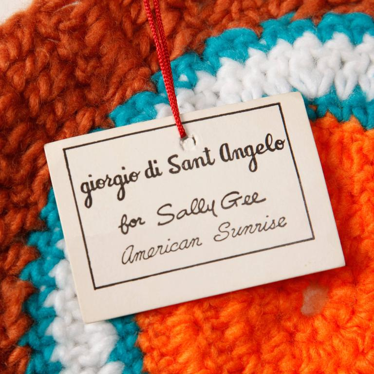"Unworn with the original tags still attached! Extremely rare 1970s Giorgio Sant'Angelo for Sally Gee ""American Sunrise"" design scarf and matching hat. Iconic bright orange, rust, teal and white color block design that Sant'Angelo was known"