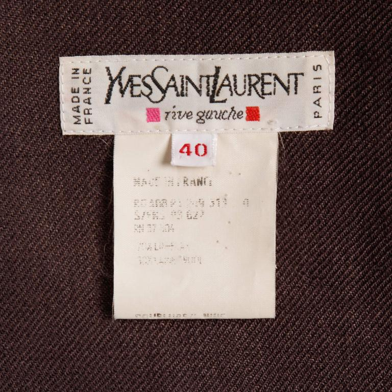 """Vintage Yves Saint Laurent Safari jacket in a brown linen and wool blend. Partially lined with front button closure. Marked size 40. Fits like a modern size large. The bust measures 42"""", waist 42"""", shoulders 16.25"""", sleeve length"""
