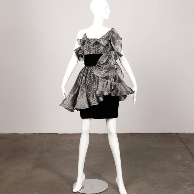 Absolutely incredible vintage Bernard Perris dress with sculptural origami pleating and avant garde shape. One shoulder cut with gray pleated organza and black velvet. Fully lined with side zip, hook and snap closure. The construction on this dress