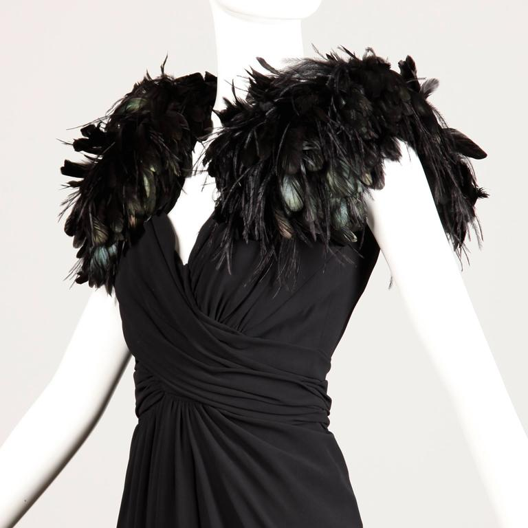 Vintage black evening dress by Lilli Diamond with feather detail on both shoulders. Fully lined with rear zip and hook closure. There is no marked size, but the dress fits like a modern size XS-S. The bust measures 32-34