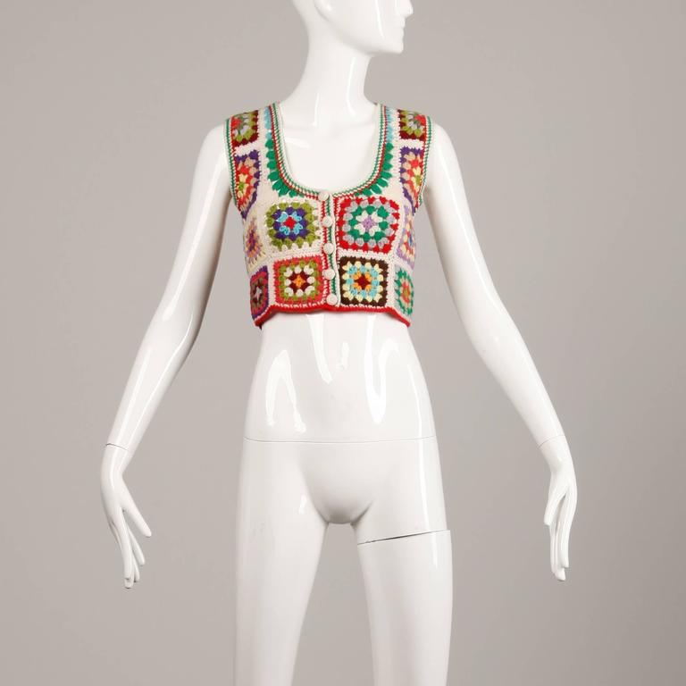 """Vibrant wool vest or top in hand crocheted Granny Squares by Adolfo. Unlined. Made in the British Crown Colony of Hong Kong. The marked size is medium but this should fit a size small as well. The bust measures 32-34"""", waist 28"""", and total"""