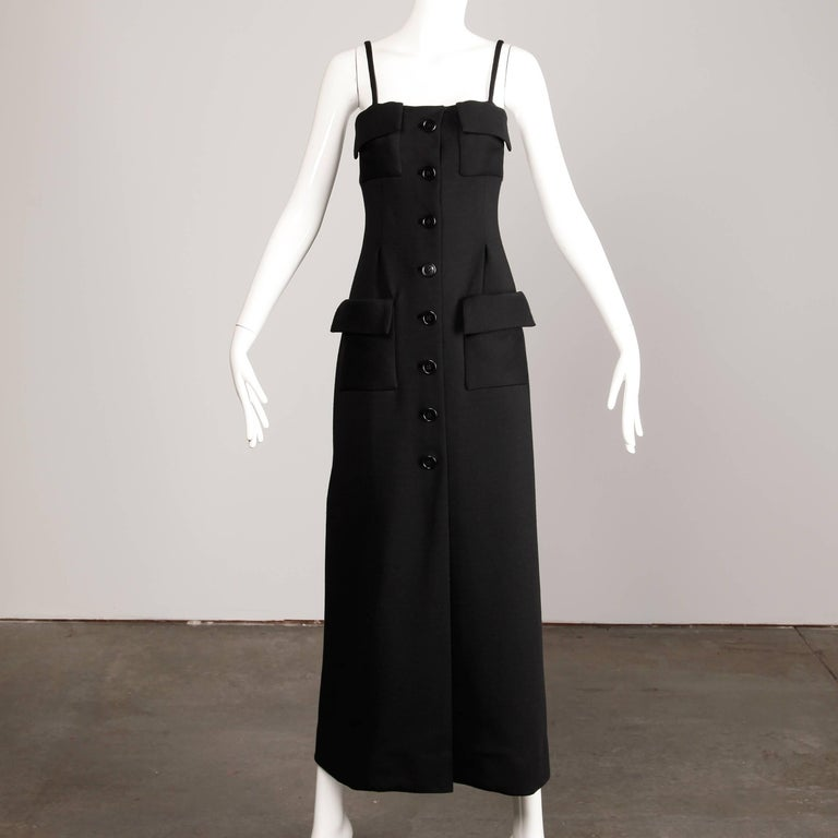"Vintage 1970s black wool maxi dress by Geoffrey Beene. Fully lined with front button and snap closure. Front patch pockets. Fits like a modern size small-medium. The bust measures 32"", the waist 28.5"", hips 35"" and the total length is"