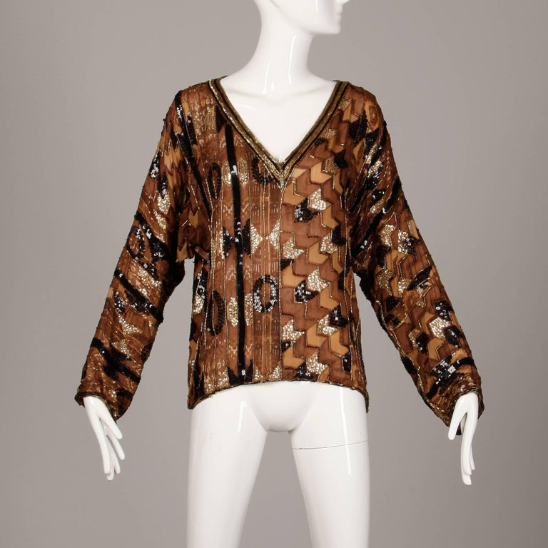 Gorgeous vintage Judith Ann brown block printed silk top with sequin and beadwork. Unlined with no closure (pulls on over the head). 100% silk. The marked size is large, but will also fit sizes small-medium due to the oversized fit. The bust