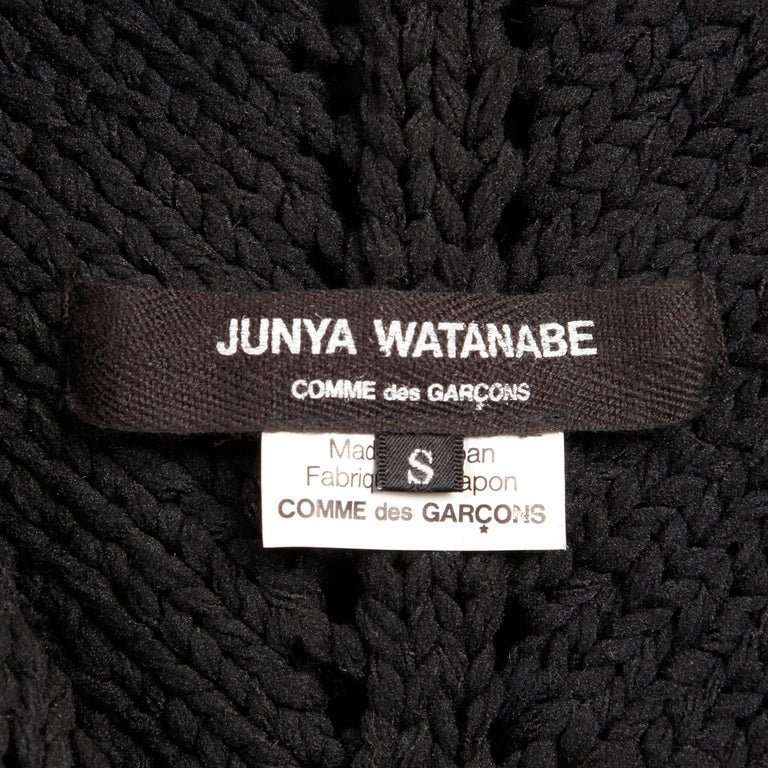 Amazing Junya Watanbe for Comme des Garcons black wool knit sweater top. Unlined with no closure (pulls on over head). The marked size is small. Stretchy black fabric is not faded (we lightened the photos to show detail). Excellent vintage condition