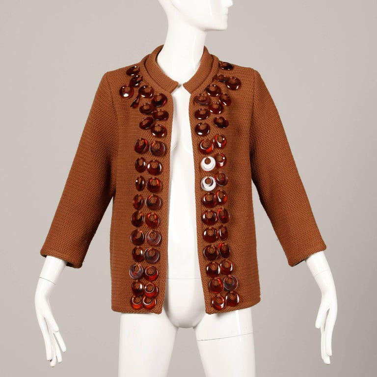 """Vintage 1960s brown wool knit cardigan sweater with plastic rings by Ethel Beverly Hills. Unlined, no closure (hangs open). Fits like a modern size small-medium. The bust measures 40"""" (closed, unstretched), waist 38"""" (closed, unstretched),"""