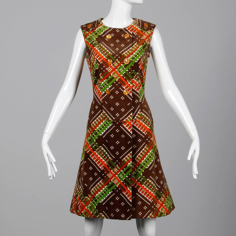 Darling vintage white, brown, orange and green geometric printed dress attributed to Malcolm Starr. We have the matching culotte/ blouse set with the Malcolm Starr label in it, but this dress only has the Sara Fredericks store label in tact. Fully