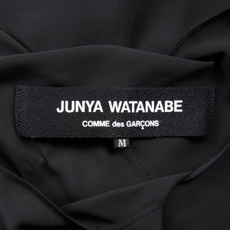 """Incredible Junya Watanabe for Comme des Garcons black avant garde draped dress. Partially lined, no closure (pulls on over the head). The marked size is medium. The bust measures 36"""", waist 28"""", hips 35"""" and the total length 45""""."""