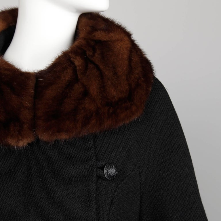 "Gorgeous 1960 black wool coat with plush brown mink fur collar in excellent condition. Fully lined with front button closure. Hidden side pockets. Fits like a modern size small-medium. The bust measures 39"", waist 37"", hips 43"", drop"