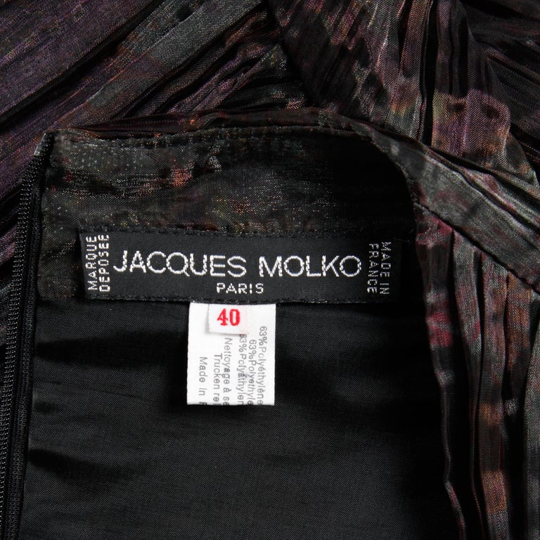 Vintage 1990s pleated iridescent cocktail dress by Jacques Molko. Fully lined with rear zip closure, built-in brassier with hook closure, and zip closure at wrists. 63% polyethylene 37% nylon. The marked size is 40, and the dress fits like a size