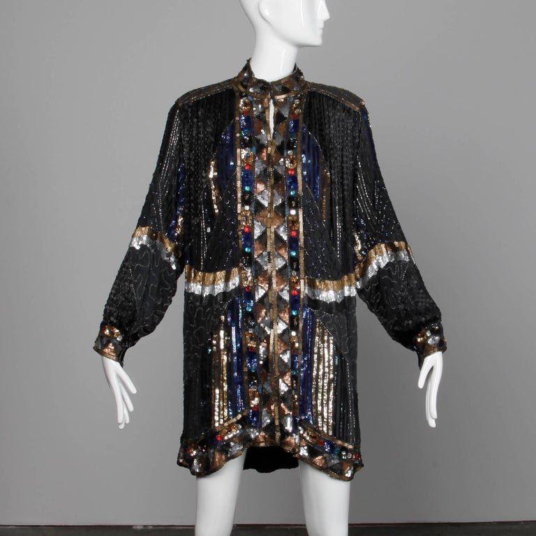 Heavily embellished silk jacket or coat with beading, sequins and rhinestones. Fully lined with front hook closure and snap closure on wrists. Structured shoulder pads can easily be removed if desired. 100% silk, with 100% rayon lining. Free size.