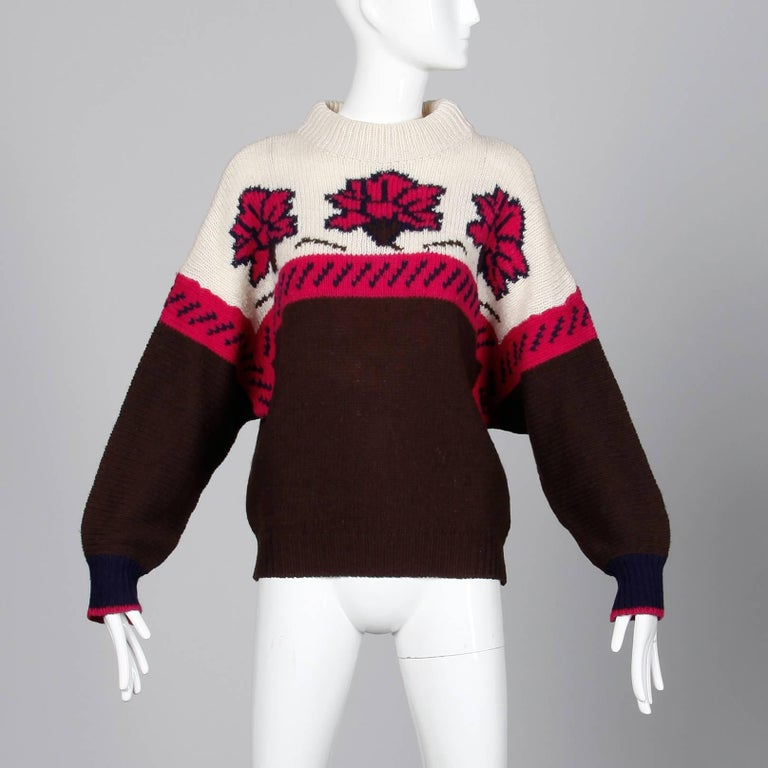 """Oversized chunky knit wool sweater by Byblos. Unlined with no closure (pulls on over the head). 100% wool. Fits most sizes S-L. The bust measures 50"""", waist 39"""",  drop shoulders 17"""", sleeve length 24.5"""" and the total length"""