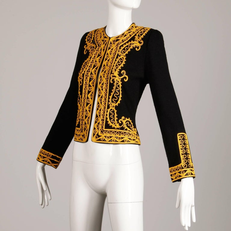 Military-inspired vintage knit cardigan sweater or jacket by Adolfo with gold soutache embroidery and beadwork. Unlined with front hook closure. External shoulder pads can easily be removed if desired. 70% wool, 30% rayon. Fits like a modern size