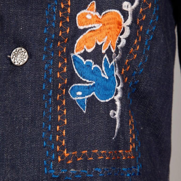 Women's or Men's 1970s Vintage Hippie Denim Jean Jacket with Orange + Blue Bird Embroidery For Sale