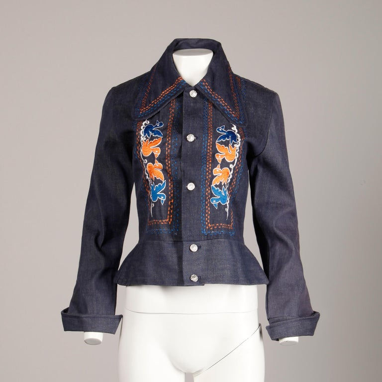 Darling vintage 1970s jean jacket with orange and blue bird embroidery and oversized collar. Unlined with front button closure. Fits like a modern size medium. The bust measures 39