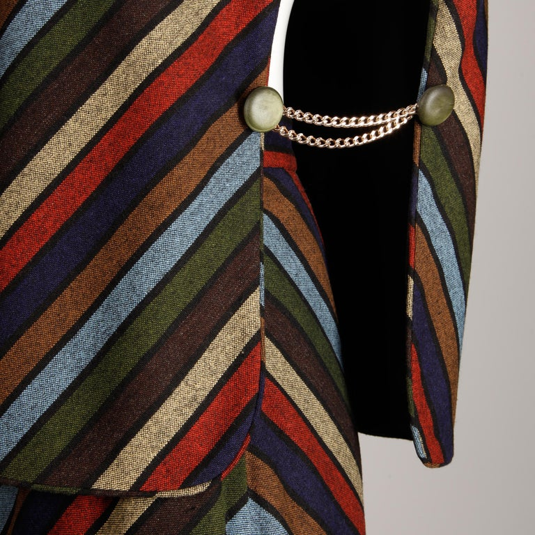 Wear together or separately! Stunning vintage 1970s wool chevron striped vest top and maxi skirt ensemble with a metal chain detail. The skirt is fully lined with side metal zip and hook closure. There is no marked size bu the ensemble fits like a