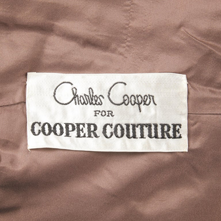 Gorgeous brown velvet vintage 1960s coat by Charles Cooper for Cooper Couture at Nan Duskin. Fully lined with front cabachon button closure. Side pockets. Fits like a modern size large. The bust measures 46