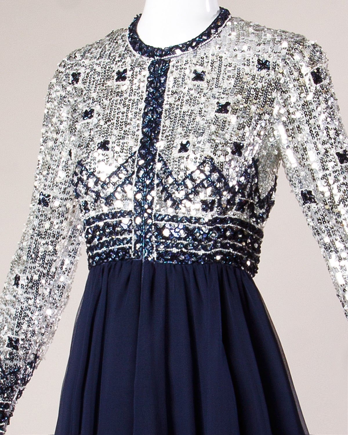 Reduced from $650. Sparkling silver and navy blue sequin and beaded dress with full layered chiffon skirt.